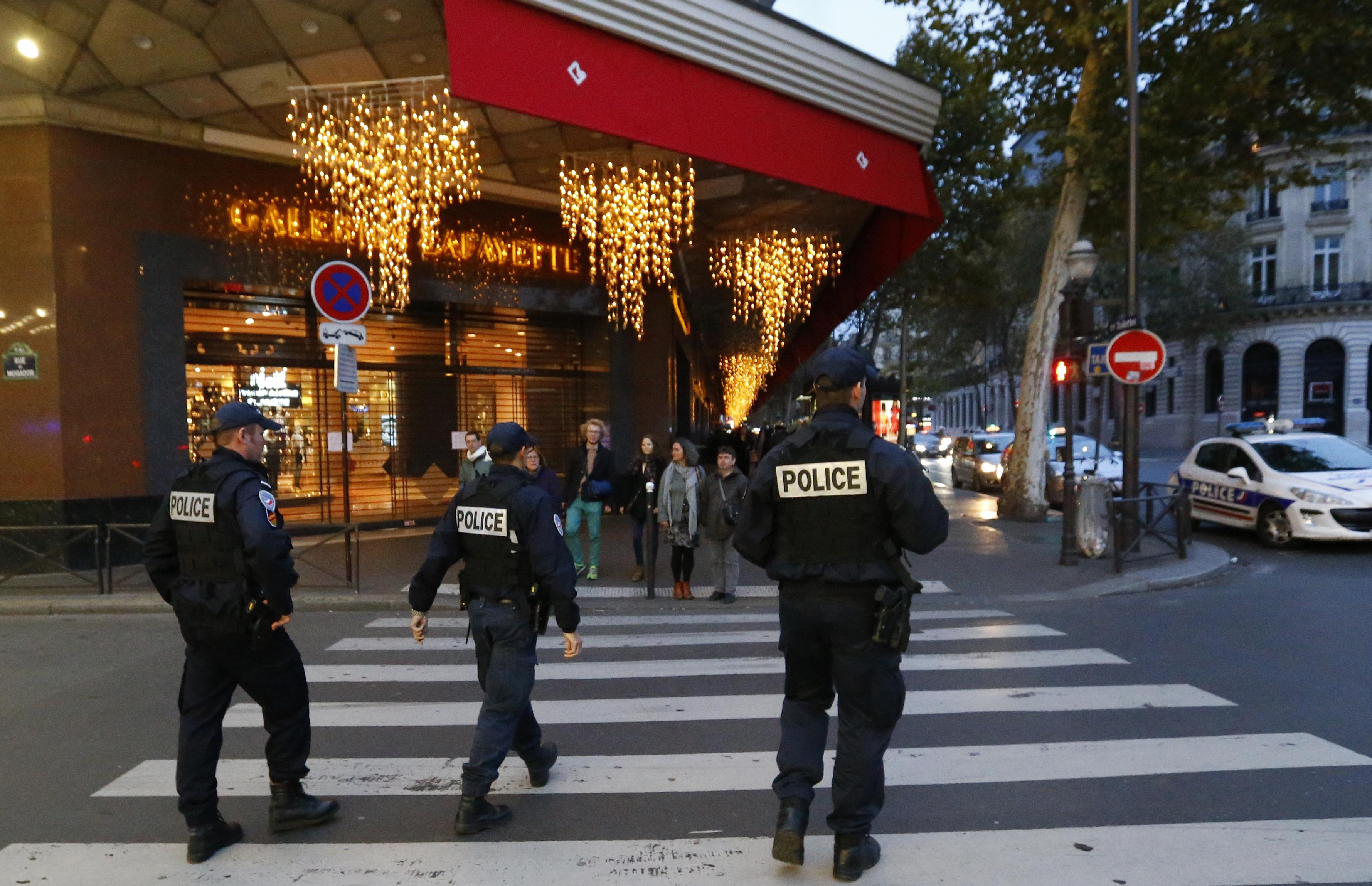 French police stand patrol in Paris