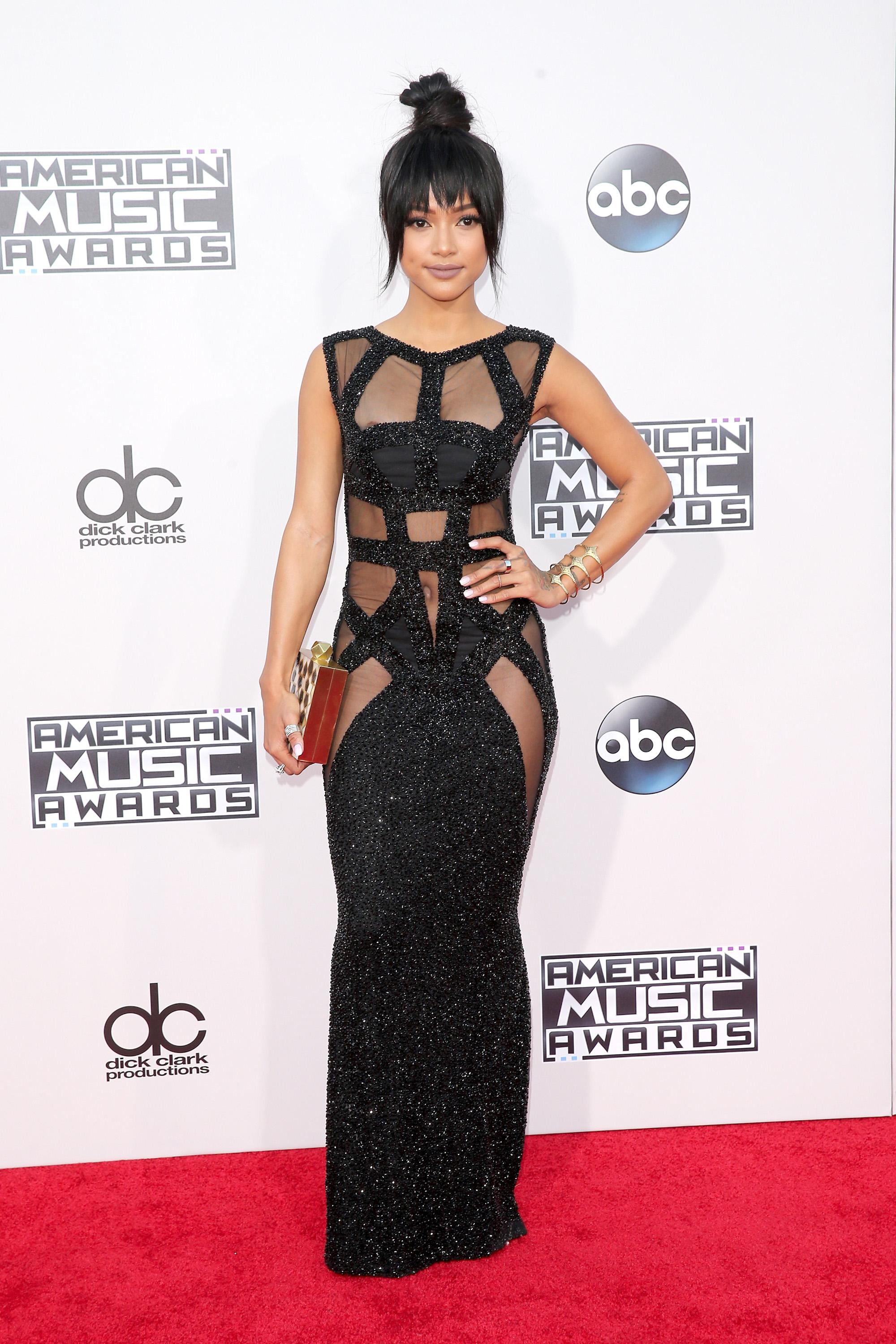 d847c6abc2 WORST: Karrueche Tran arrived at the 2015 AMAs, held at the Microsoft  Theater in Los Angeles on Nov. 22, 2015, sporting a strappy gown with her  hair in a ...