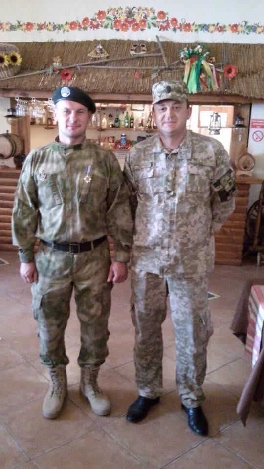 Alexey Litvinenko standing next to an unknown and high ranking Ukrainian officer.