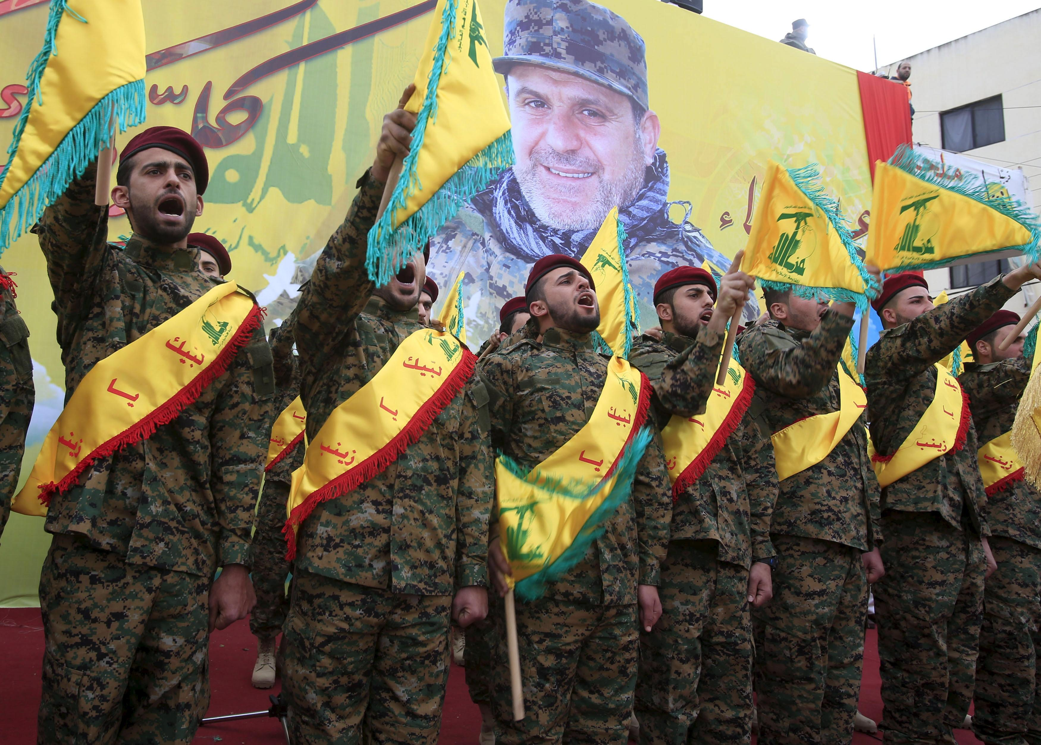 Hezbollah members chant during a funeral in Lebanon.