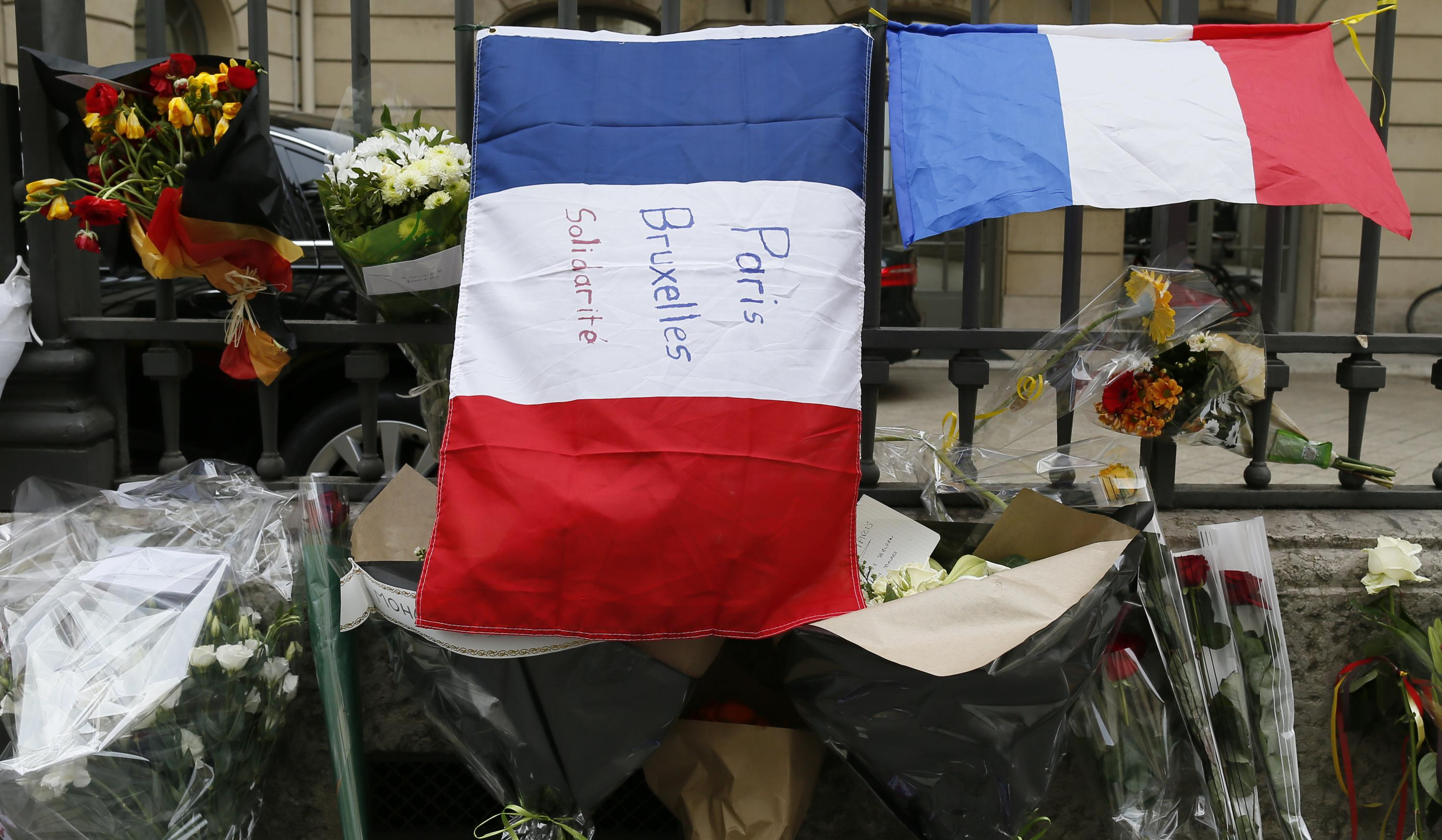 A French flag in Paris with a message for victims in Brussels.