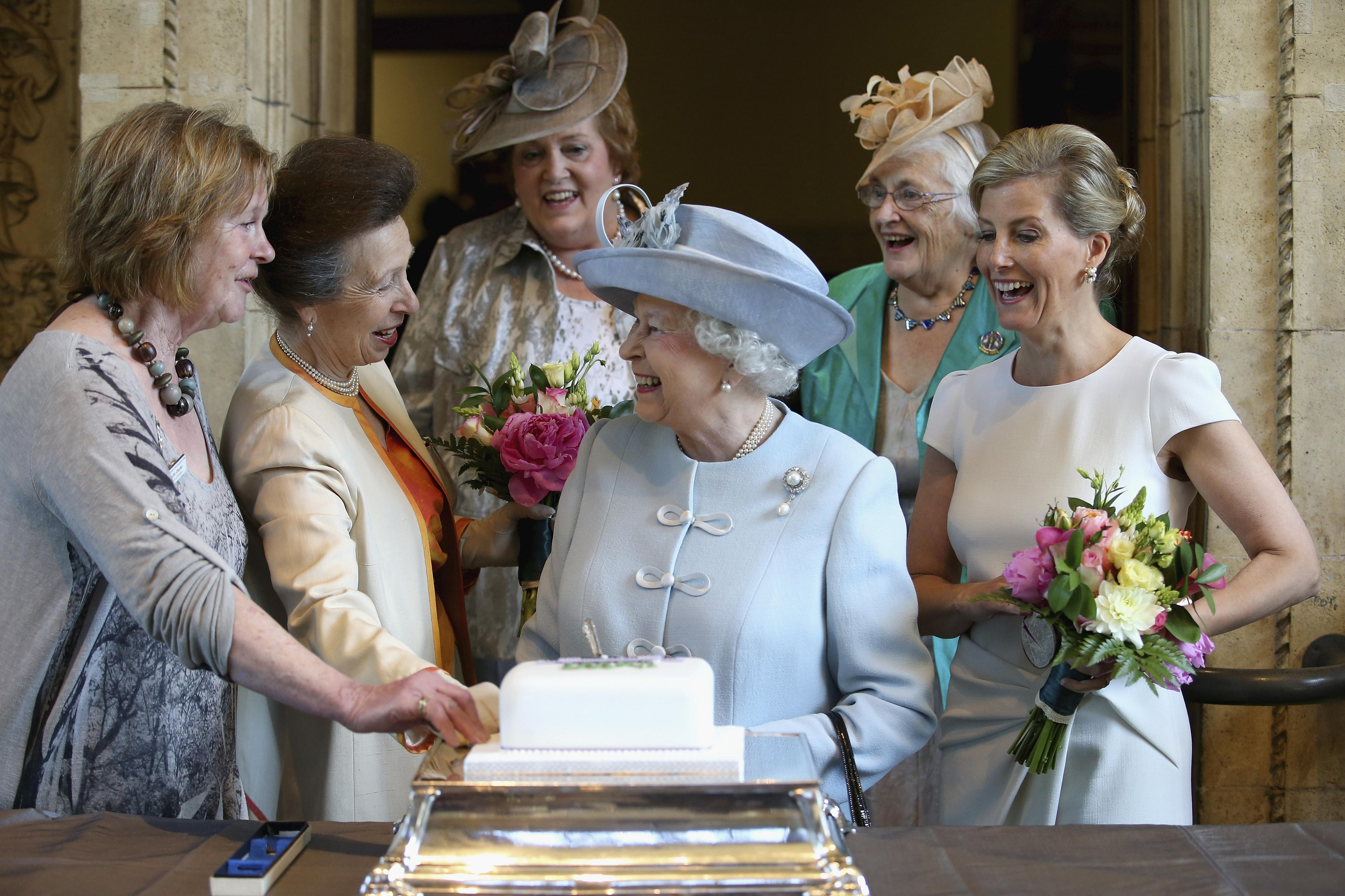Queen Elizabeth flanked by Sophie, Countess of Wessex (R) and Princess Anne (2nd L)