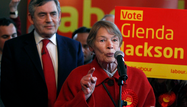 LONDON, ENGLAND - MAY 02: Britain's Prime Minister Gordon Brown listens as former actress and Labour Party MP Glenda Jackson speaks during a party meeting in a pub in Kilburn on May 2, 2010 in London, England