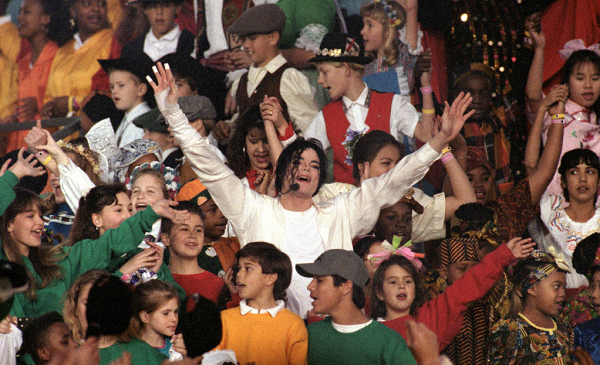 Michael Jackson performs 'Heal the World' during the Halftime show as the Dallas Cowboys take on the Buffalo Bills in Super Bowl XXVII at Rose Bowl on January 31, 1993