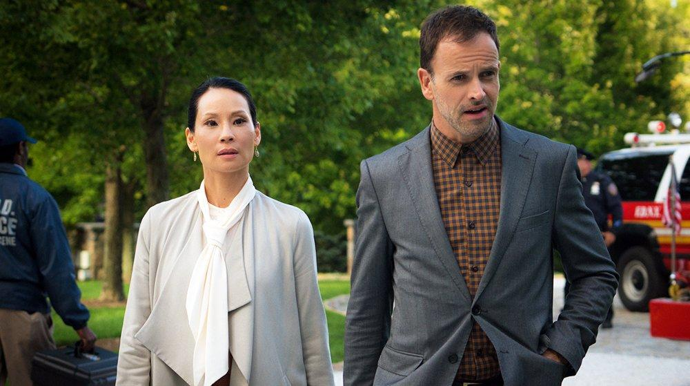 Lucy Liu as Joan, Jonny Lee Miller as Sherlock