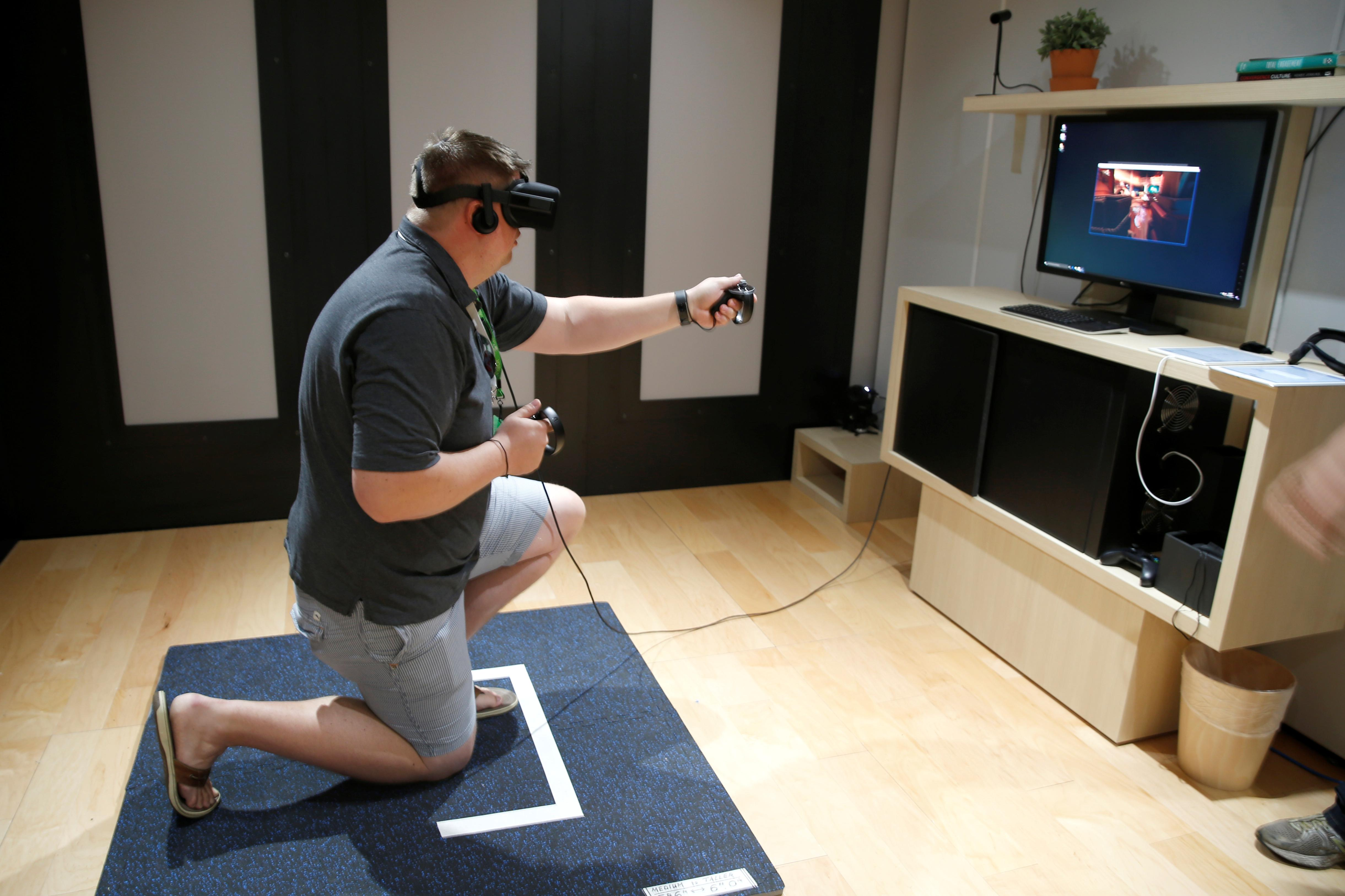 dd534a41c214 A man plays a video game with the Oculus Rift VR headset at the E3  Electronic Expo in Los Angeles