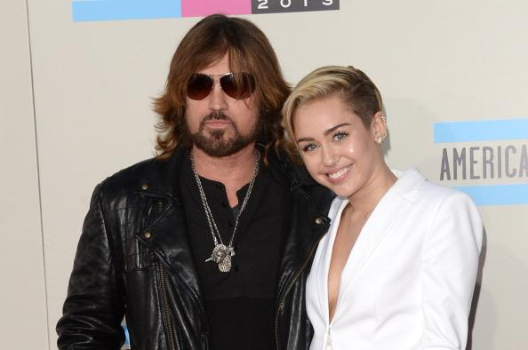 Miley's toned down look is result of being 'sexualized,' she says