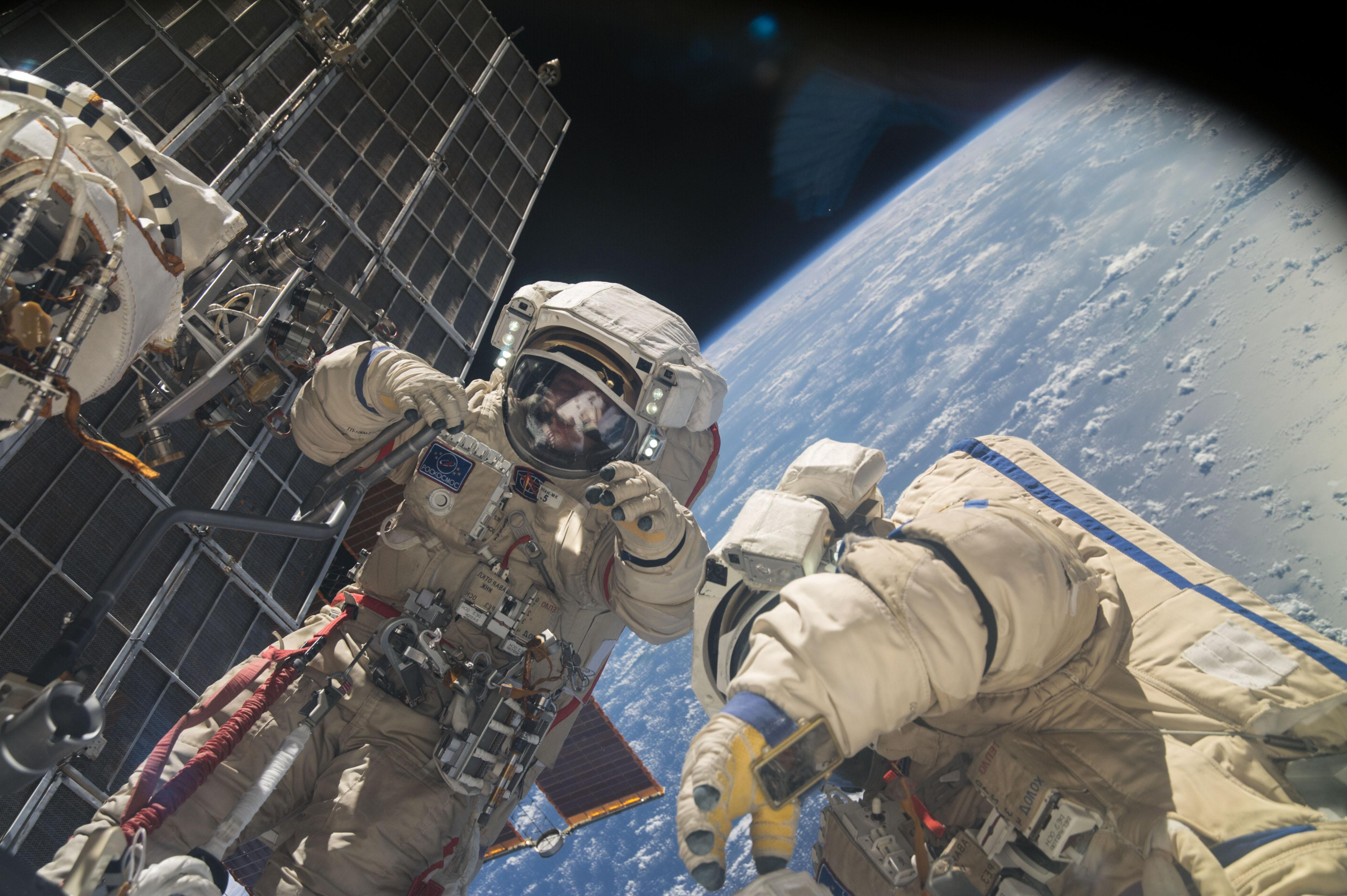 Two Astronauts Go Out into Outer Space