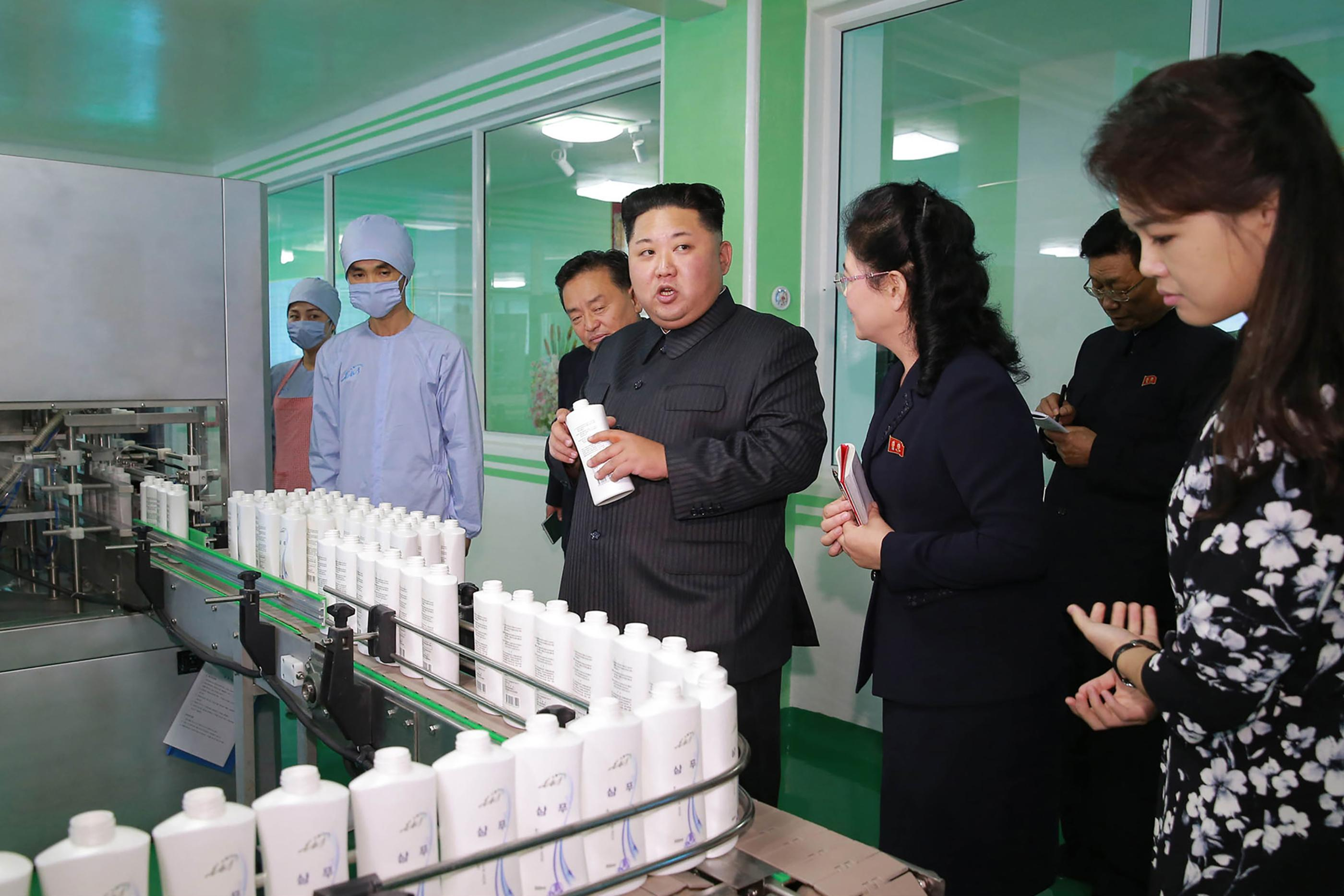 Kim Jong-un visits cosmetics factory with wife and sister