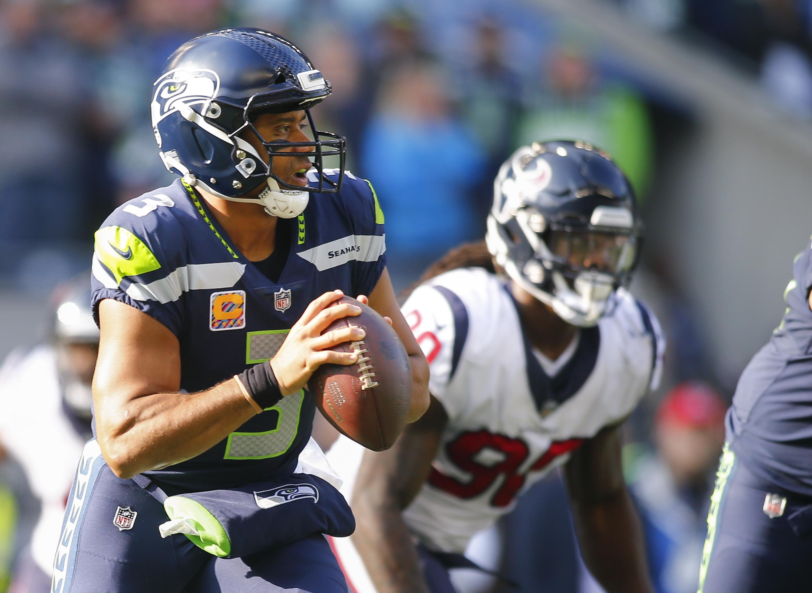 Seattle Seahawks QB Russell Wilson reworked contract to help sign Duane Brown
