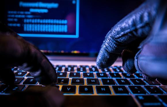 hacker-bitcoin-cryptocurrency-money-finances-laptop-illegal-getty_large
