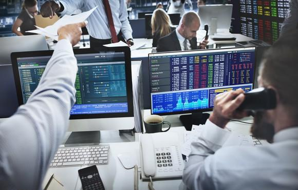 stock-traders-in-front-of-computers-on-phone-getty_large
