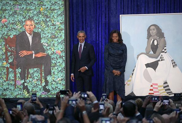 Adorable toddler enamored by portrait of Michelle Obama