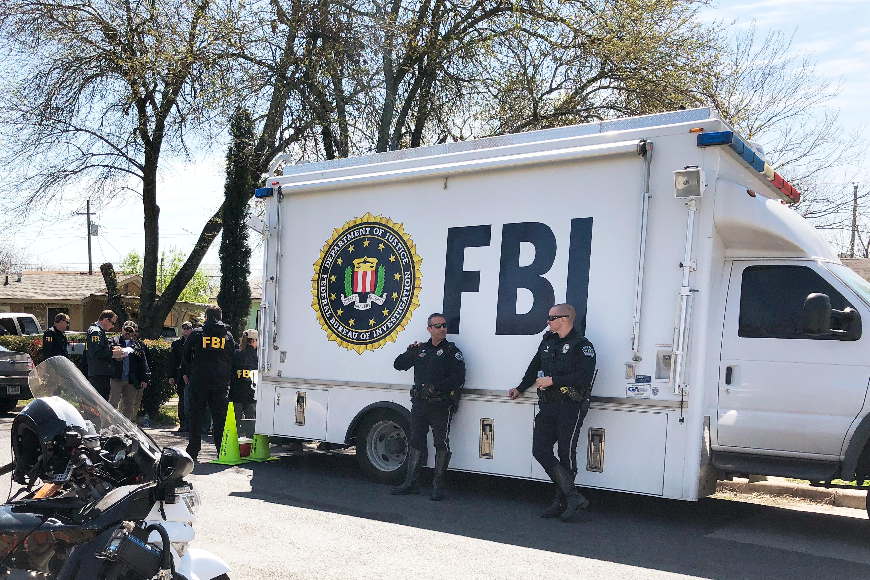 Law Enforcement Personnel Including Fbi Agents Are Seen Near A Home That Was Hit With A Parcel In Austin Texas March