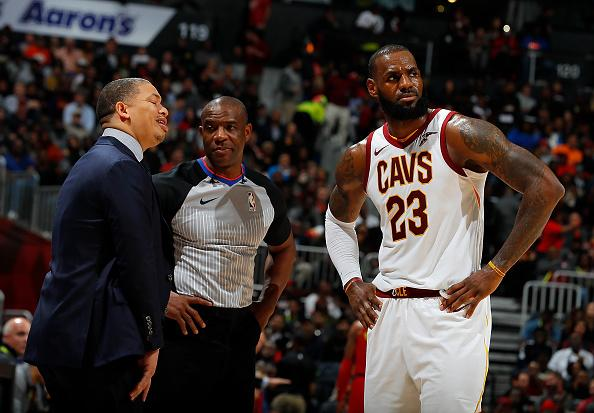 NBA Cleveland Cavs coach Lue stands aside
