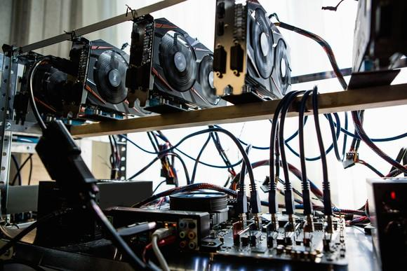 computer-graphic-cards-bitcoin-ethereum-miner-mining-cryptocurrency-getty_large (1)
