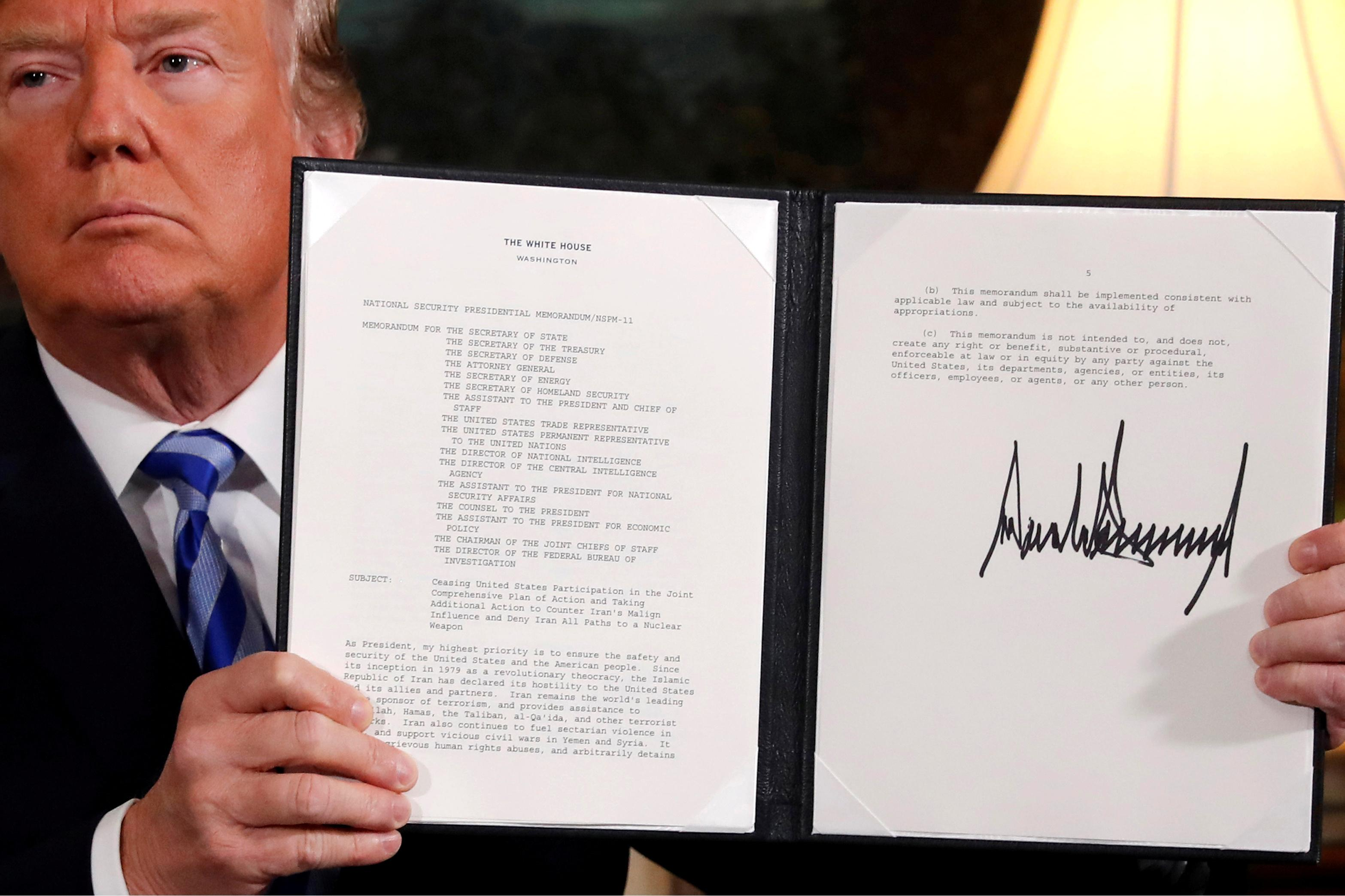 U.S. President Donald Trump holds up a proclamation