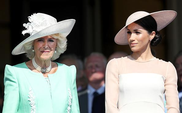 Camilla and Meghan [19659011] Meghan Markle, Camilla Parker Bowles will join Queen Elizabeth II and the other Royals with the exception of Kate Middleton at the 100th anniversary celebration of the RAF. Pictured: Camilla and Markle attend the Prince of Wales 70th Birthday Patron Celebration, held May 22, 2018 in London at Buckingham Palace. </span> <span class=