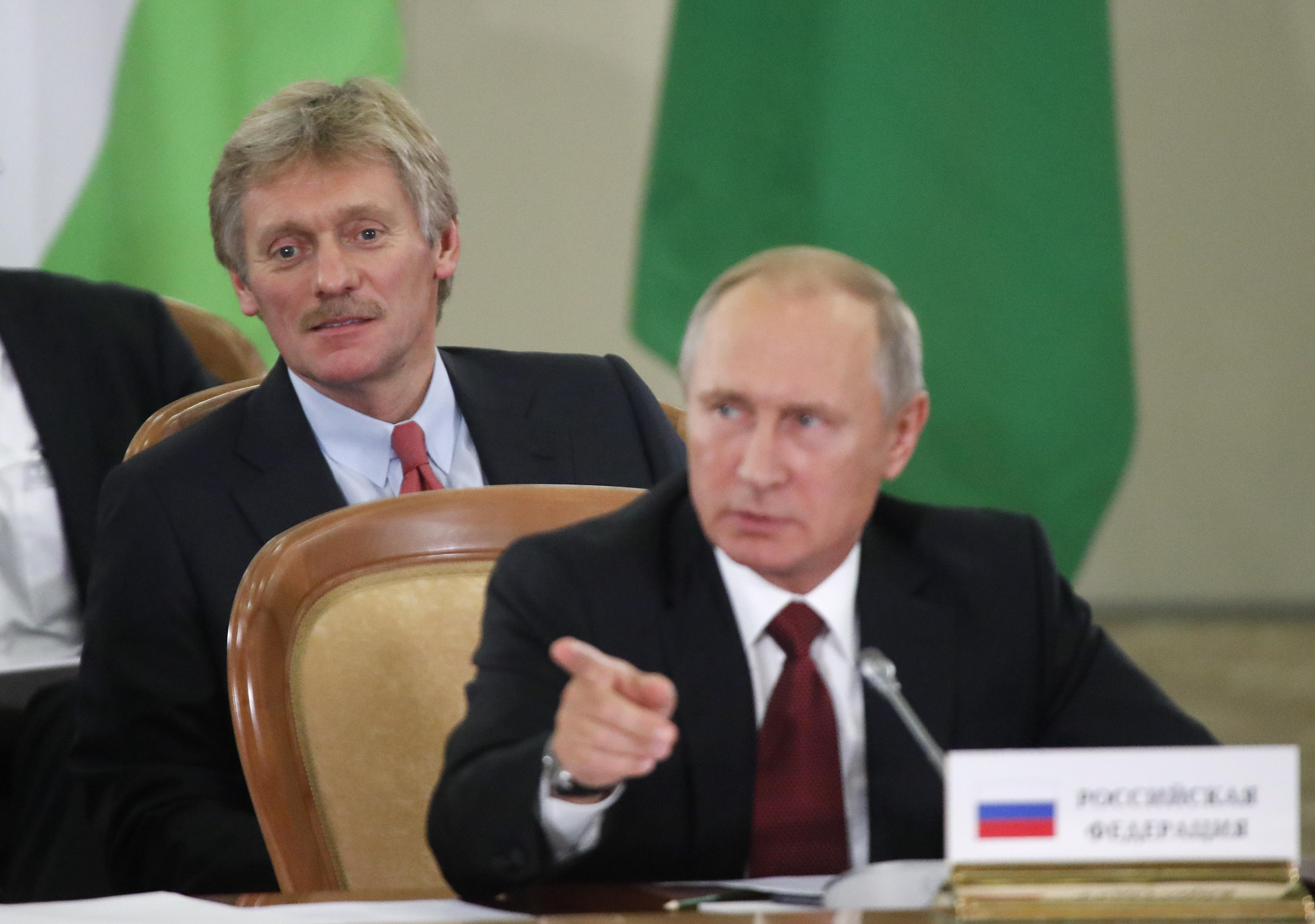 Putin and Peskov [19659014] Russian President Vladimir Putin (front) and Kremlin spokesman Dmitry Peskov attend a meeting of the Council of Heads of State of the Commonwealth of Independent States (CIS) in Sochi, Russia, on 11 October 2017. </span> <span class=