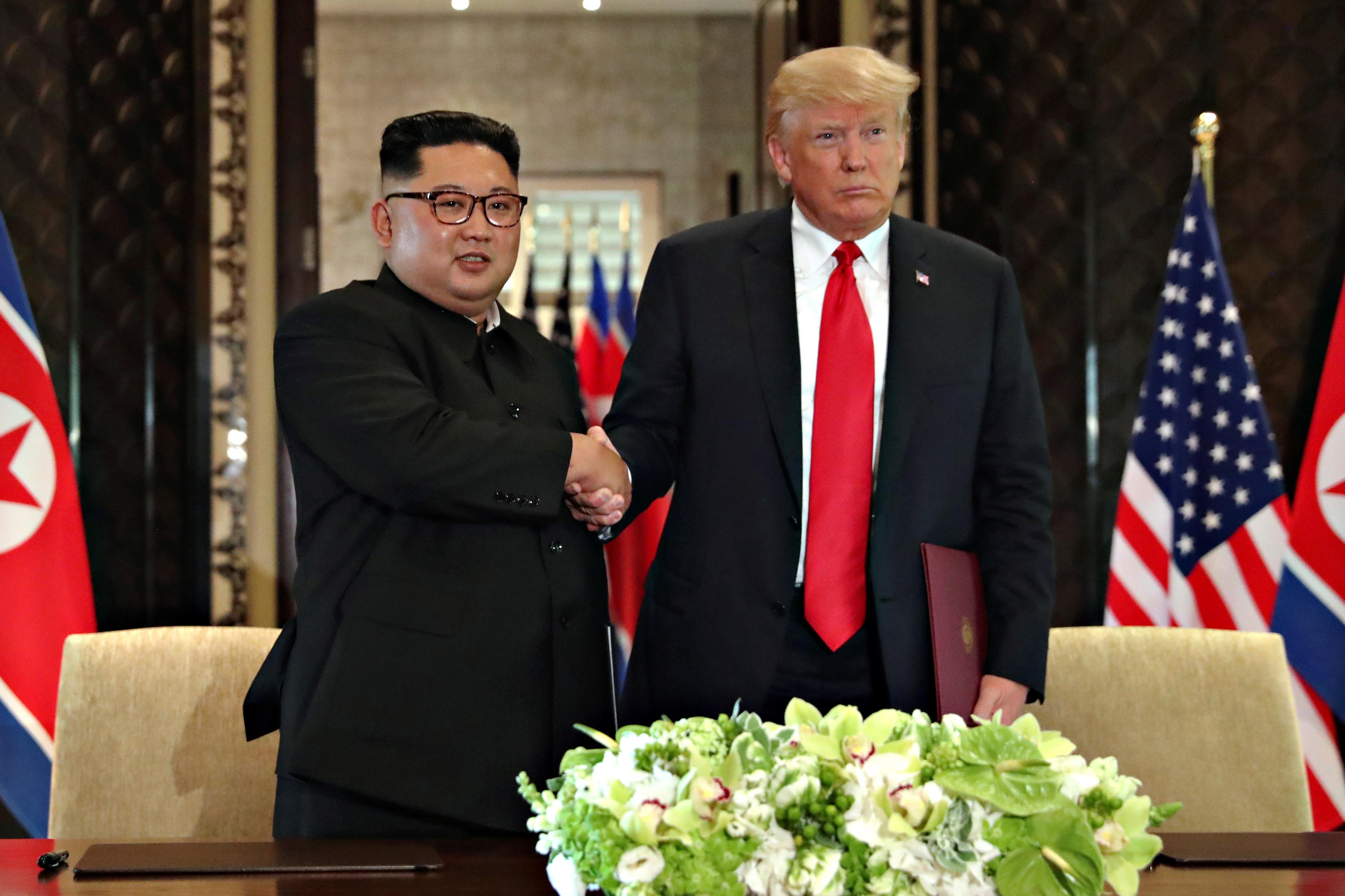 Trump and Kim sign document