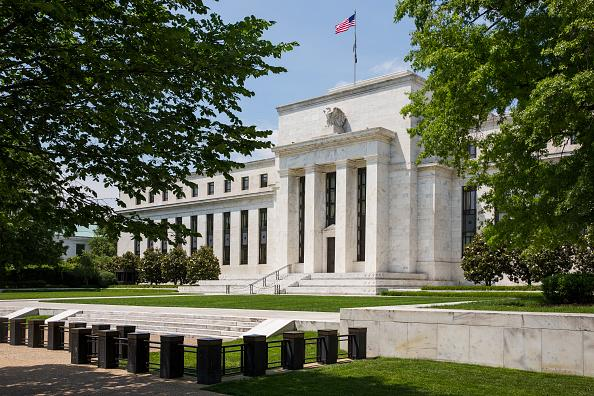 Fed Raises Interest Rates, Signals Faster Hikes on the Way