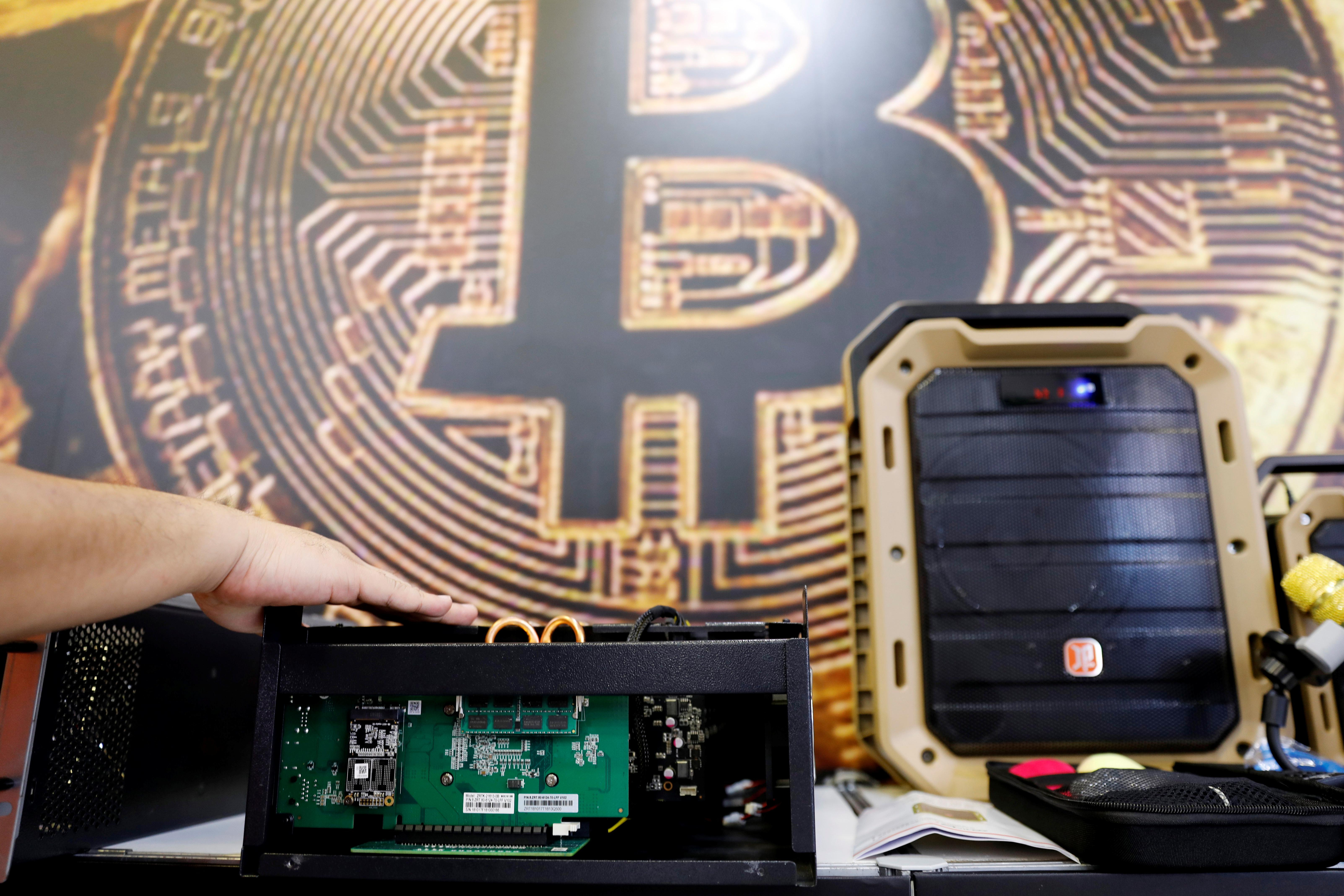 Here A Cryptocurrency Mining Computer Is Seen In Front Of Bitcoin Logo During The Annual Computex Exhibition Taipei Taiwan June 5 2018