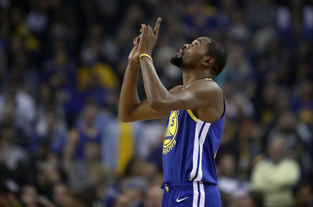 After Warriors-Raptors overtime battle, Kevin Durant gives his jersey to Drake