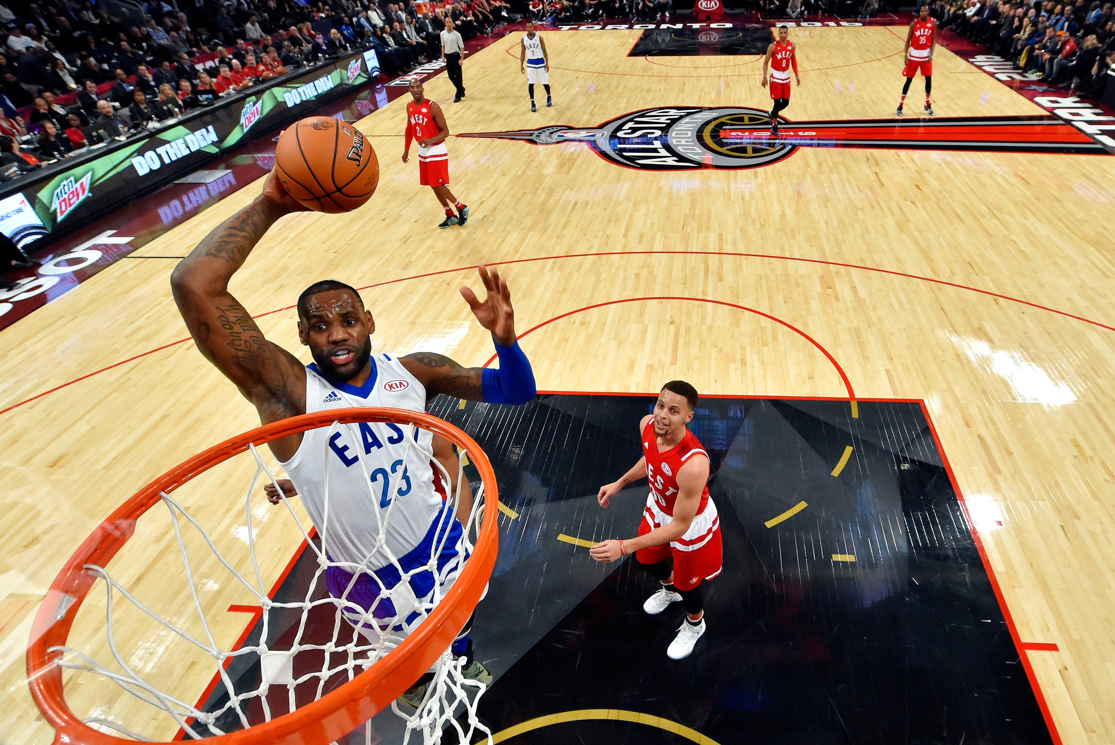 cc115a503c2 nba all star LeBron James  23 of the Cleveland Cavaliers and the Eastern  Conference goes up for a dunk in the first half against Stephen Curry  30  of the ...