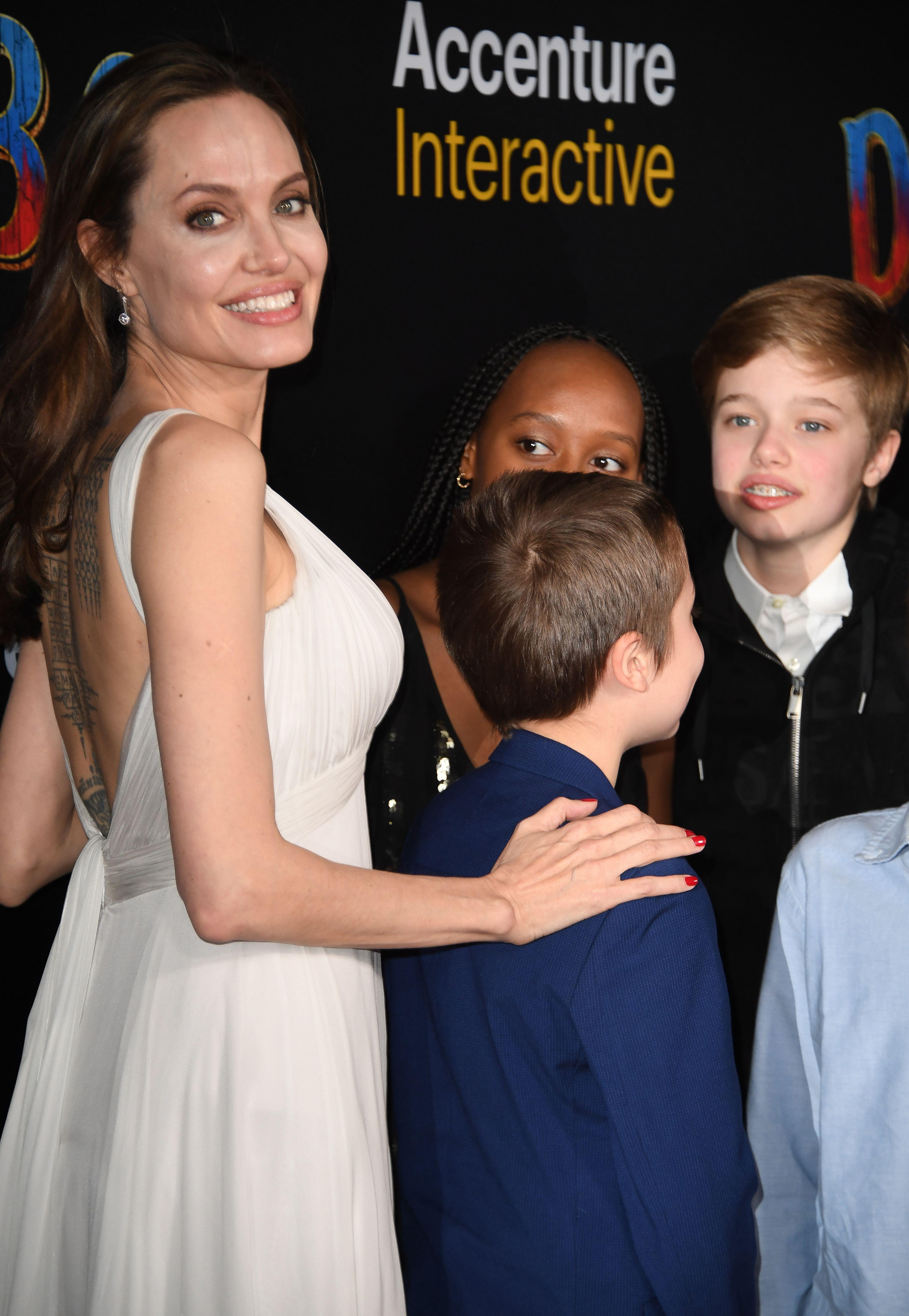 Angelina Jolie Stuns In Backless Dress, Shows Off Extensive