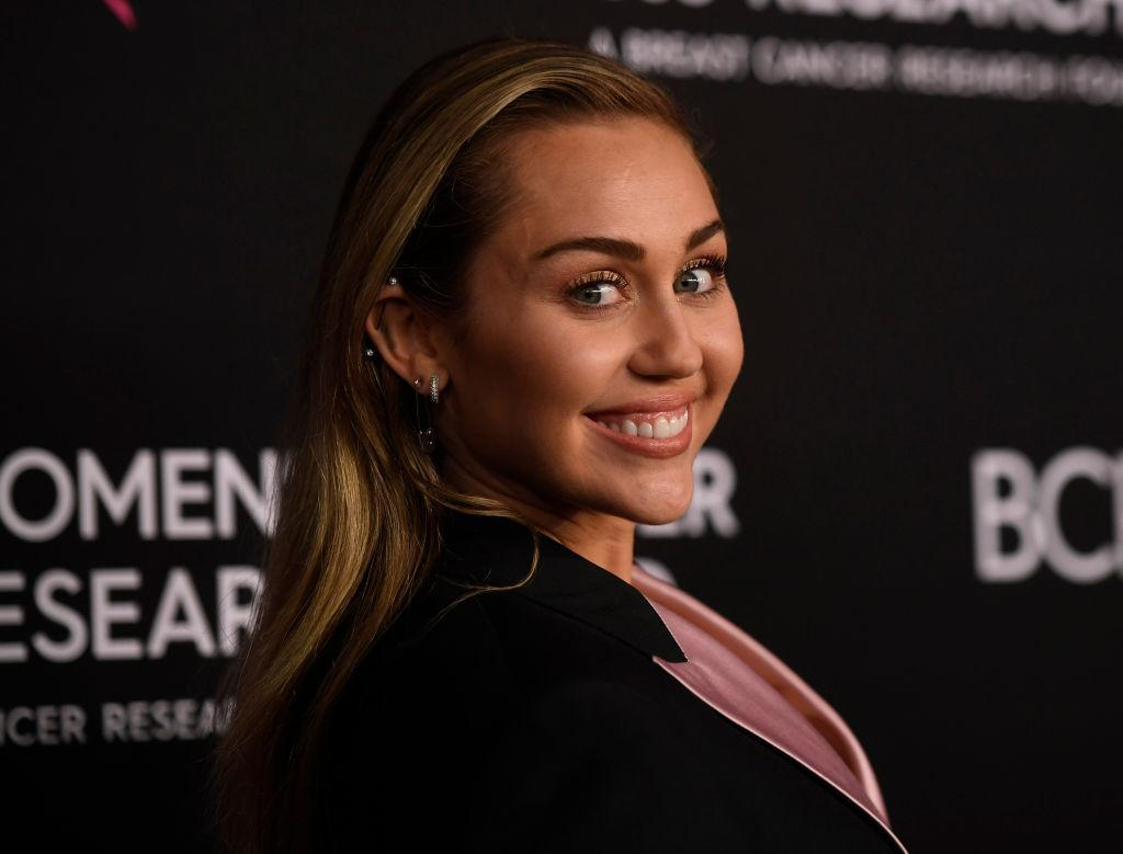 Miley Cyrus criticized for posing in a Joshua tree, causing potential damage