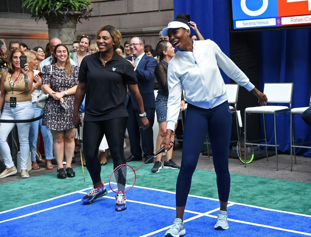 Serena Williams, left, and her sister Venus took time from US Open preparations to play badminton in New York