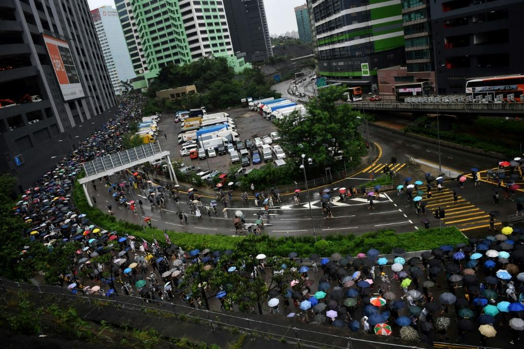 Thousands of people who had gathered at a sports stadium marched in the pouring rain to Tsuen Wan in Hong Kong