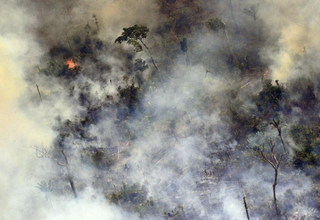 Aerial picture showing smoke from a two-kilometre-long stretch of fire billowing from the Amazon rainforest about 65 km from Porto Velho, in northern Brazil, on August 23, 2019