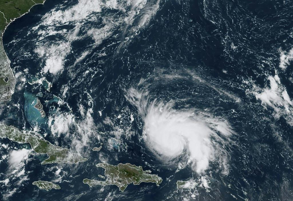 Tropical Storm Dorian is pictured approaching north-northwest of Puerto Rico in the Caribbean on its movement toward Florida, in a satellite image obtained from NOAA/RAMMB