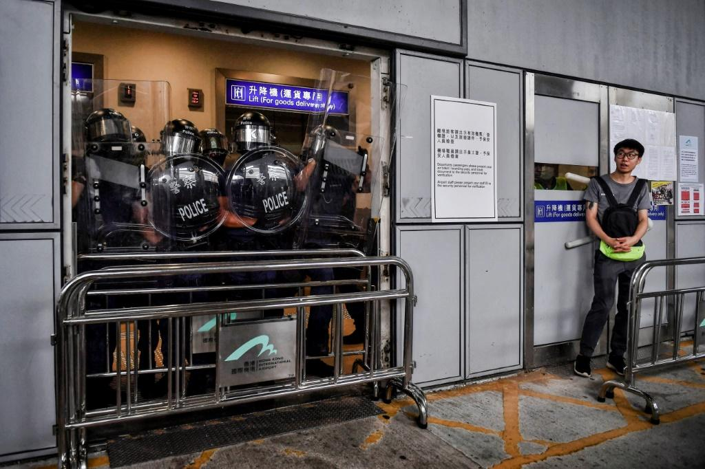 Riot police block an entrance at Hong Kong International Airport on September 1 to stop protesters from entering the terminal building