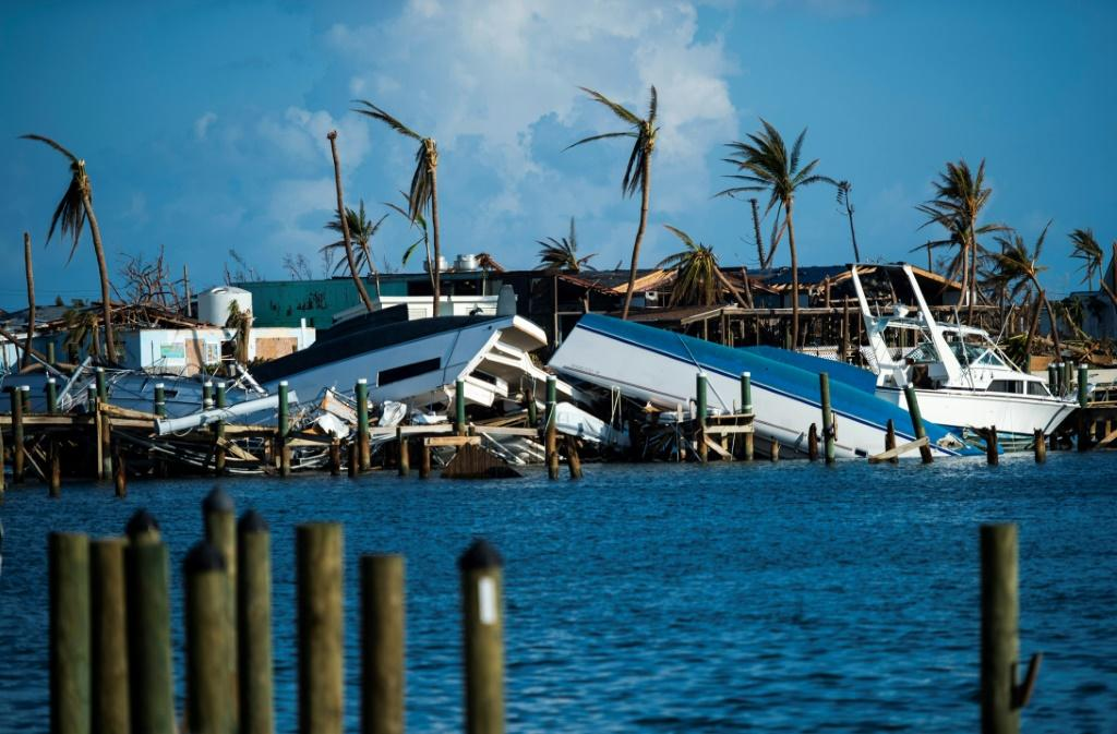Destroyed boats are pushed up against the pier in the aftermath of Hurricane Dorian in Treasure Cay on Abaco island, Bahamas