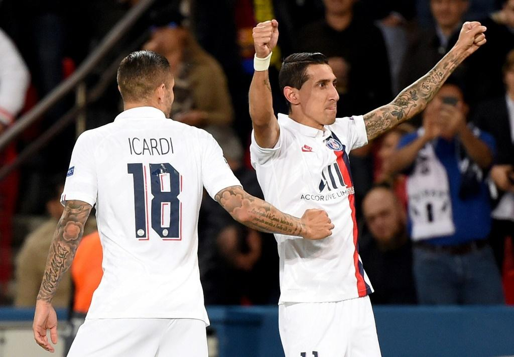 Angel Di Maria celebrates with Mauro Icardi after scoring one of his two goals as Paris Saint-Germain beat Real Madrid 3-0 in their Champions League opener