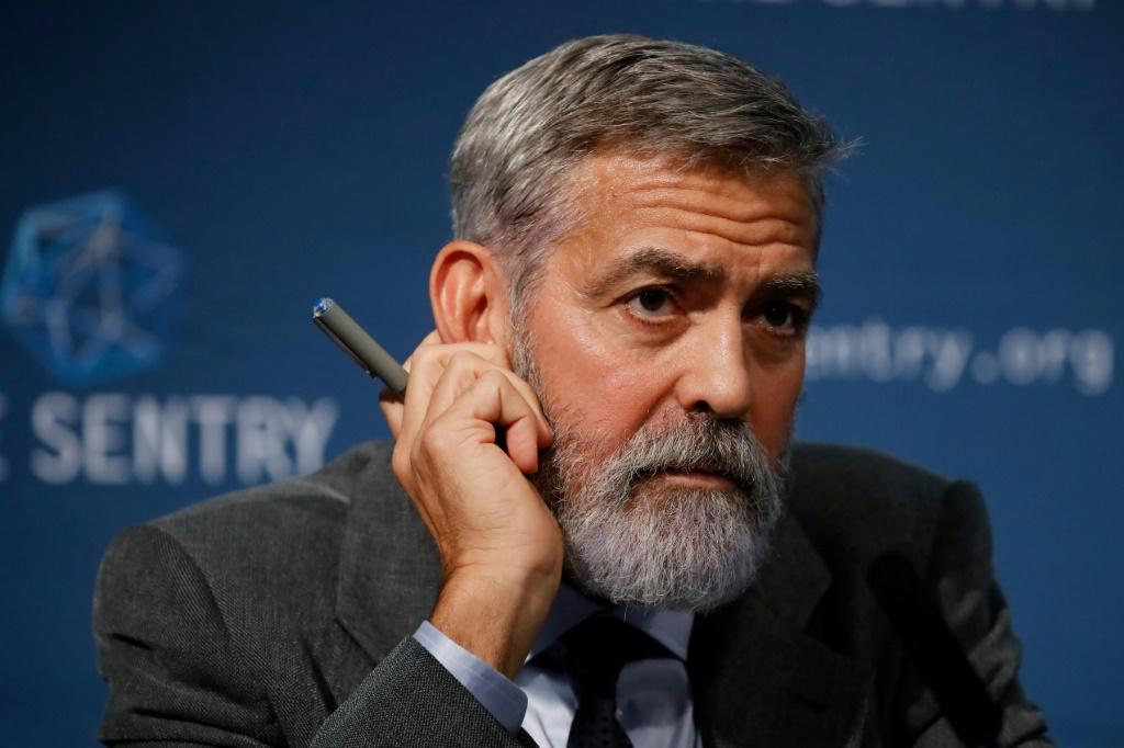 US actor George Clooney takes part in a press conference in central London to present a report on corruption in South Sudan