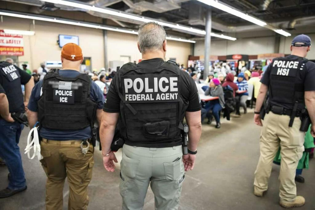 US Immigration and Customs Enforcement (ICE) and Homeland Security Investigations (HSI) officers execute search warrants on August 7, 2019, as part of a mass roundup of undocumented immigrants in the southeastern US state of Mississippi