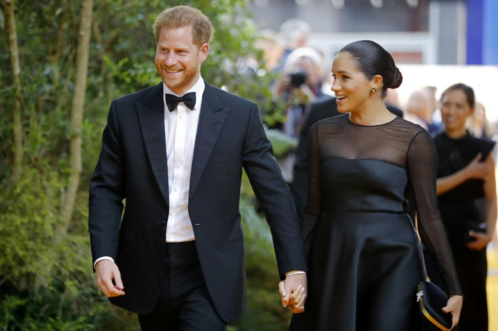 Britain's Prince Harry and his wife Meghan will be on their first official tour as a family