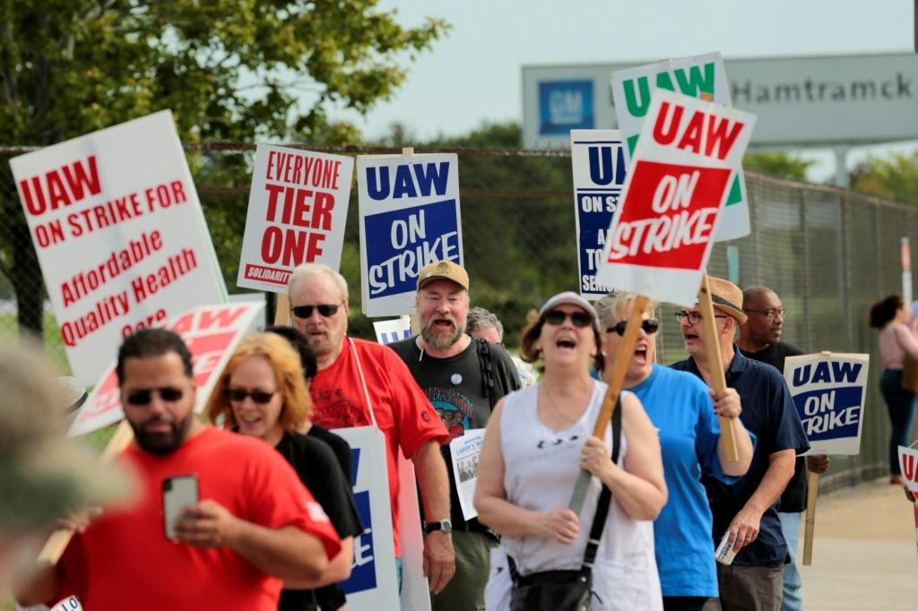 Members of the United Auto Workers (UAW) and supporters picket outside the General Motors Detroit-Hamtramck Assembly plant in Detroit, Michigan, as they strike on September 22, 2019
