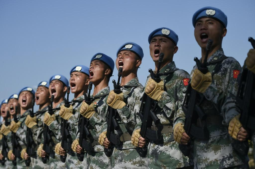 Chinese troops take part in marching drills ahead of an October 1 military parade to celebrate the 70th anniversary of the founding of the People's Republic of China