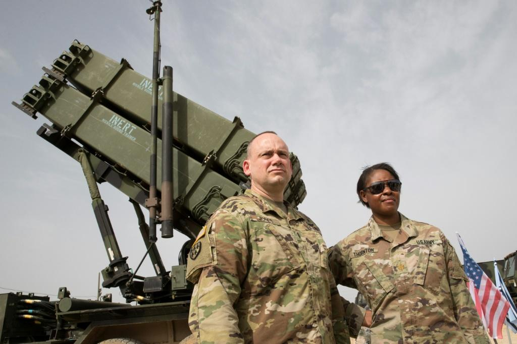 US Army officers stand in front a US Patriot missile system during 2018 exercises in Israel