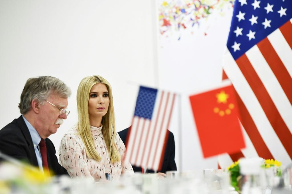 Then US national security advisor John Bolton sits next to President Donald Trump's daughter and adviser Ivanka Trump during a June 2019 meeting with Chinese President Xi Jinping on the sidelines of a G20 summit in Osaka