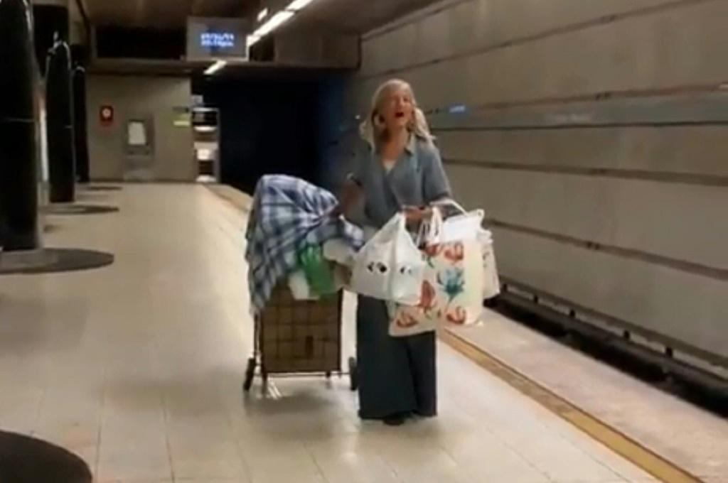 This handout video frame grab from the Los Angeles Police Department shows a homeless woman singing opera in the Los Angeles metro on September 26, 2019