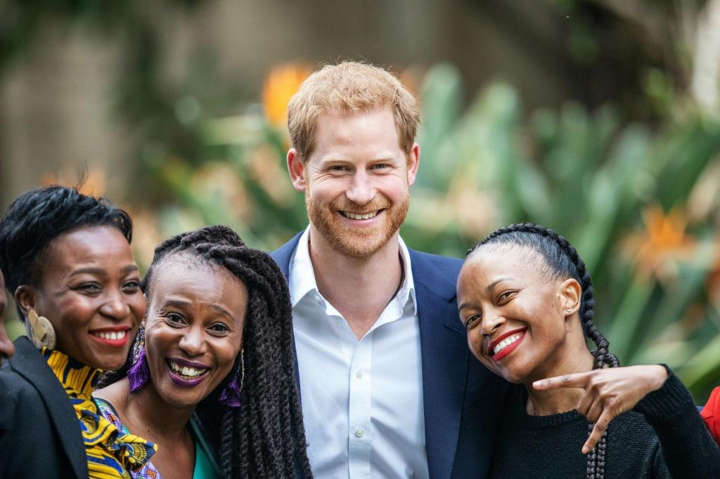 All smiles: Prince Harry at the British High Commissioner's residency