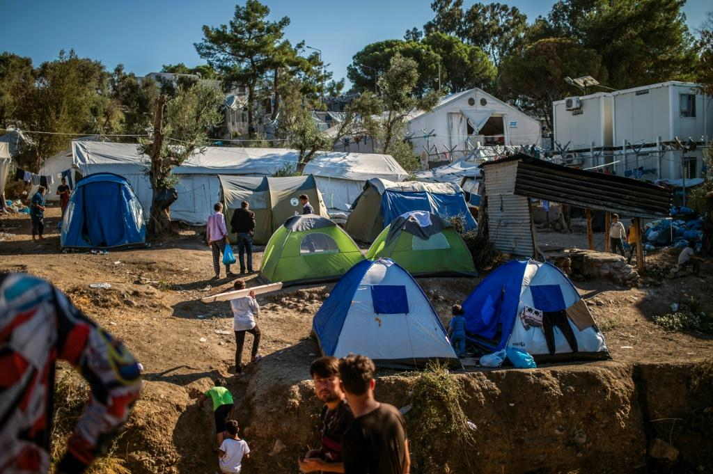 In addition to poor hygiene and frequent outbreaks of violence, many of the residents sleep in tents and complain of having to queue for hours to obtain food, take a shower or use a toilet