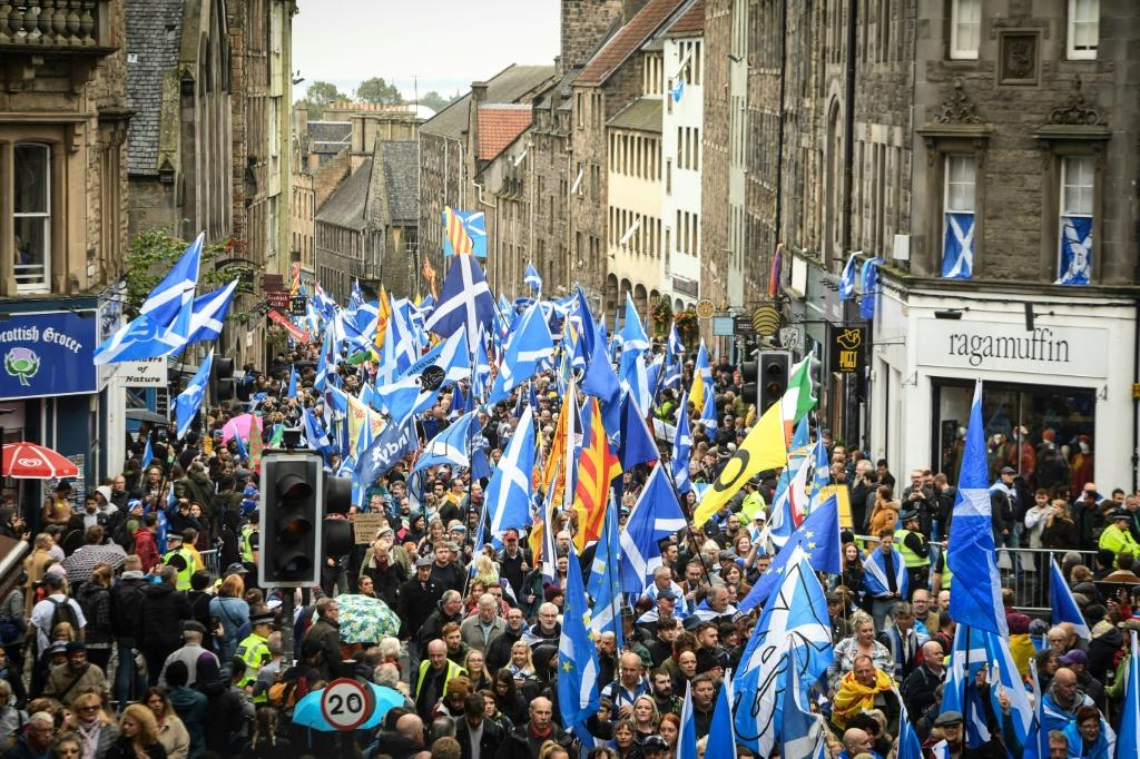 Many demonstrators carried Scottish flags and some played music along the way