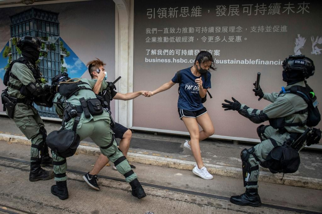Police chased down a couple wearing facemasks in the Central district in Hong Kong