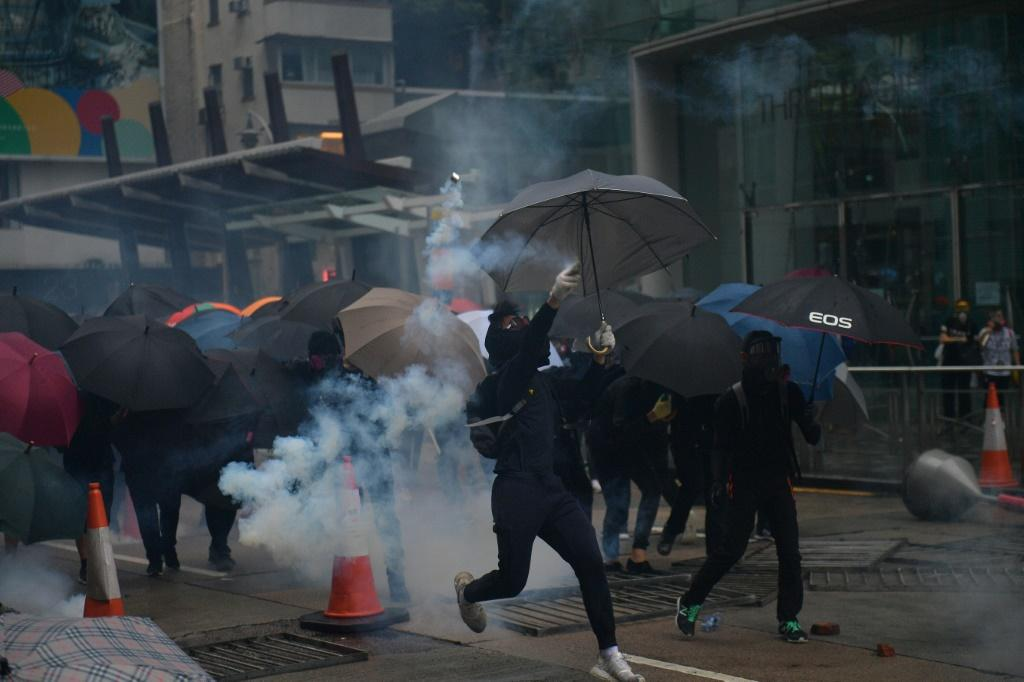 Hong Kong police fired tear gas at pro-democracy protesters after tens of thousands hit the streets once more